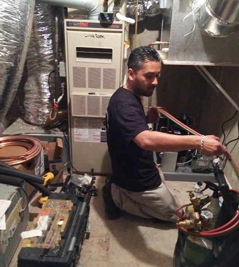 Mario Morales, founder of M&M Cellar Systems, is Welding the Refrigeration Lines for the Wine Cellar Beverly Hills Project