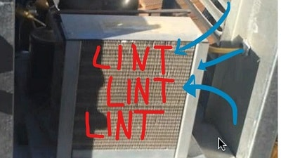 Placing a cooling unit on a low roof next to a dryer exhaust vent proved costly.