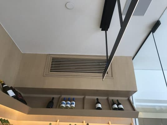 Air duct for glass wine cellar cooling system in Orange County
