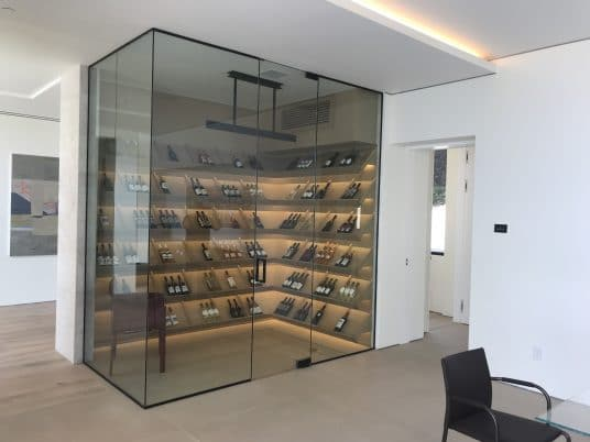 modern main floor glass wine cellar